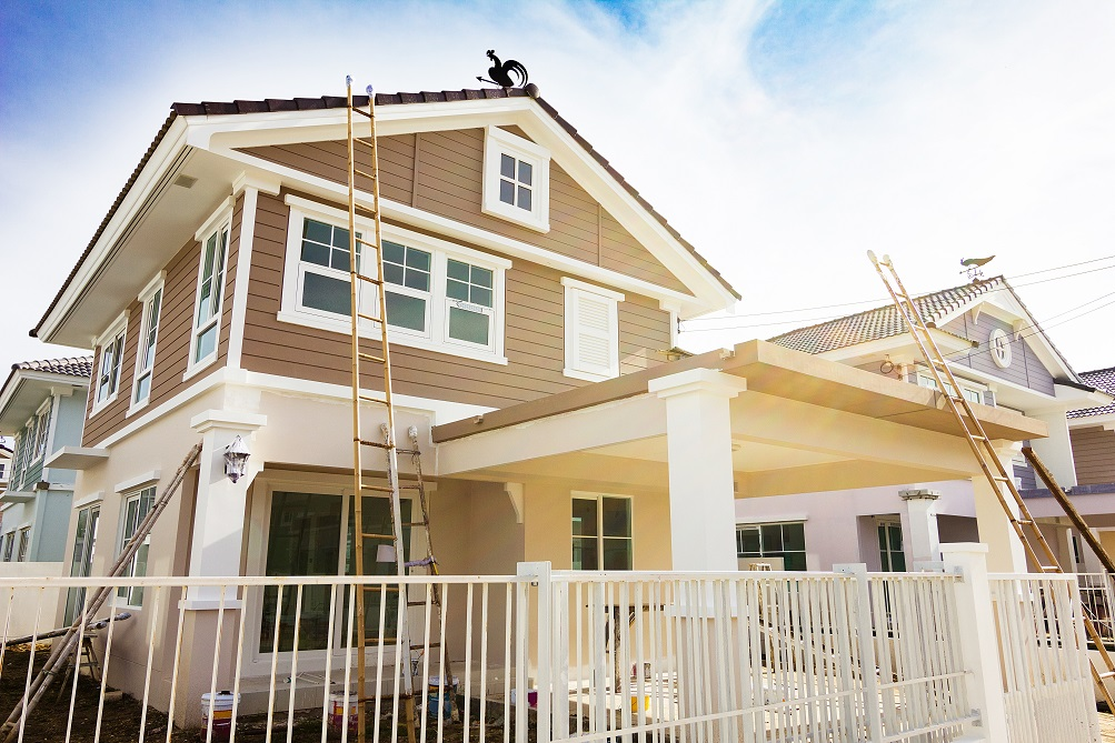 How do I prepare the exterior of my house for painting